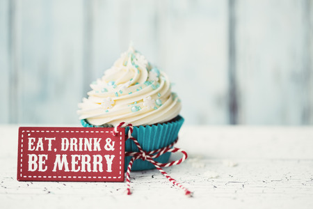 christmas drink: Cupcake with Eat, drink and be merry sign Stock Photo