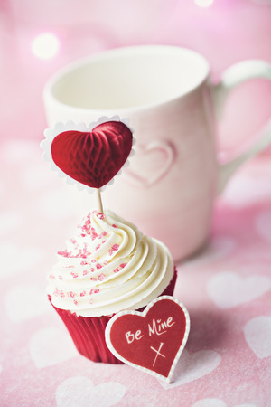 cake pick: Cupcake decorated with a heart shaped cake pick Stock Photo