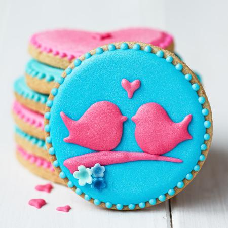 Stack of lovebird cookies 스톡 콘텐츠