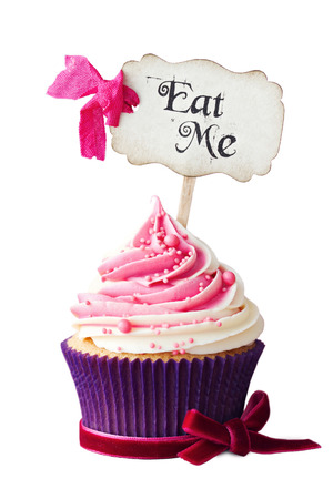 Raspberry ripple cupcake with Eat Me pick photo