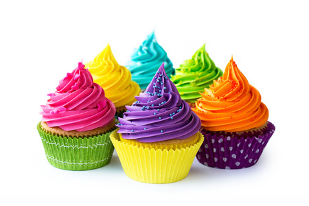 Colorful cupcakes against a white background Foto de archivo
