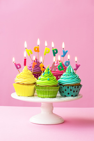 dessert stand: Happy birthday cupcakes on a cakestand Stock Photo