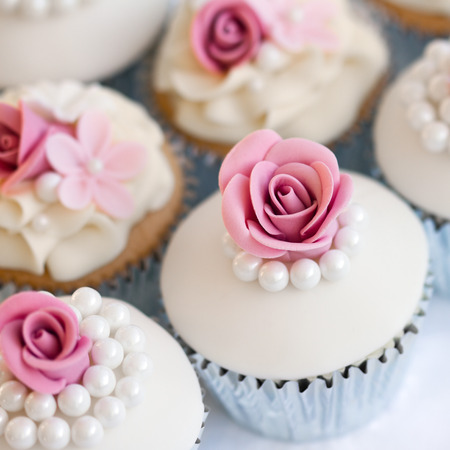 fondant: Wedding cupcakes in silver foil wrappers Stock Photo