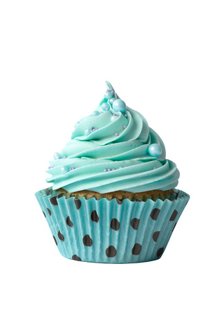 Cupcake decorated with turquoise frosting Imagens