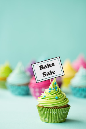 bake sale: Cupcake with Bake Sale sign