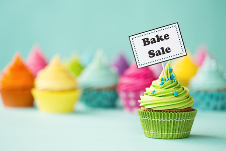 baking cake: Cupcake with Bake Sale sign