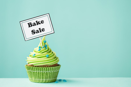 banner ad: Cupcake with Bake Sale sign