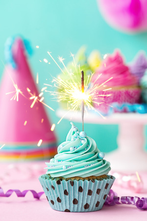 pastel: Birthday cupcake with sparkler Stock Photo