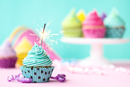 party pastries: Birthday cupcake with sparkler Stock Photo