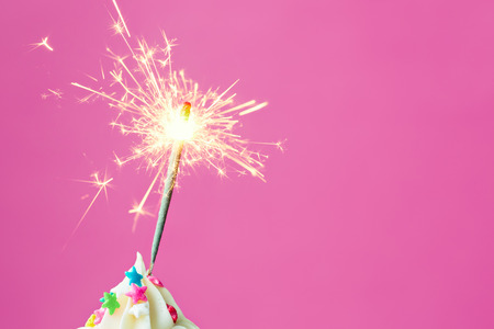 Sparkler on a cupcake with copy space to side Stock Photo