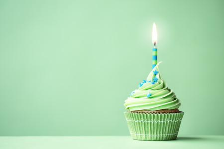 first birthday: Green birthday cupcake with copy space to side