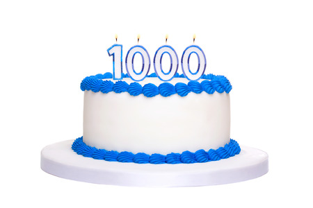 thousandth: Birthday cake with candles reading 1000