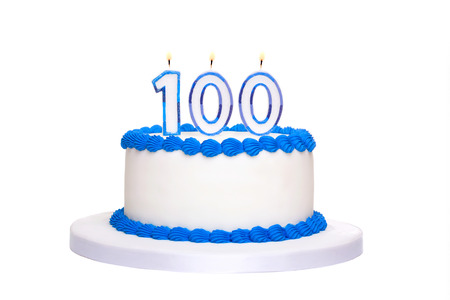 Birthday cake with candles reading 100
