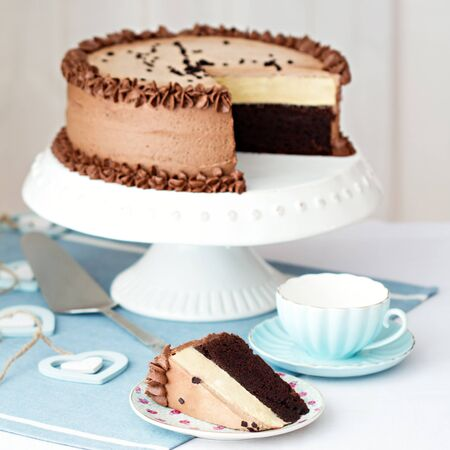 layer cake: Chocolate layer cake on a cake stand Stock Photo