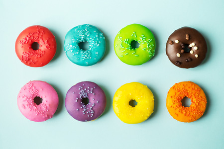 cake with icing: Colorful donuts on a blue background Stock Photo
