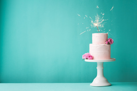 pink wedding: Birthday cake with sparkler Stock Photo