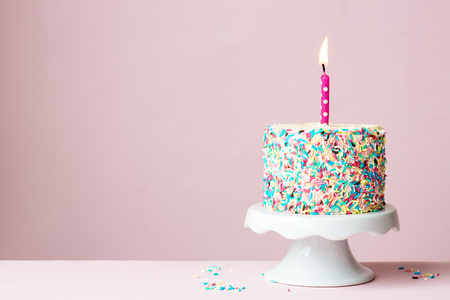cakestand: Birthday cake with one candle