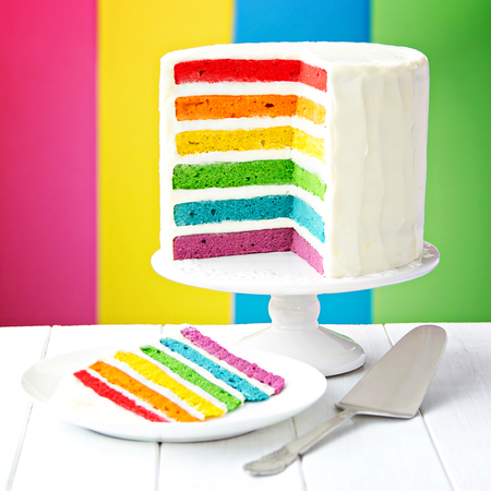 Rainbow layer cake on a cake stand