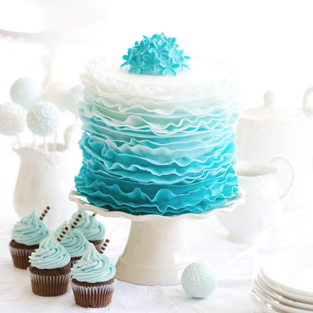 ombre cake: Ombre ruffle cake on a dessert table