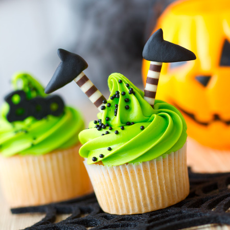Halloween cupcake decorated with witchs legs Stock Photo