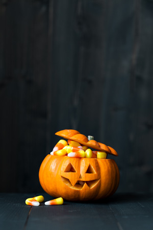 filled: Jack-o-lantern filled with candy corn. Stock Photo