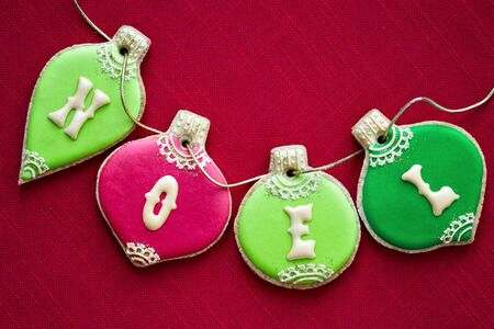 baking christmas cookies: Christmas bauble cookies in red and green Stock Photo