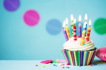 Colorful birthday cupcake with single candle Stock Photo