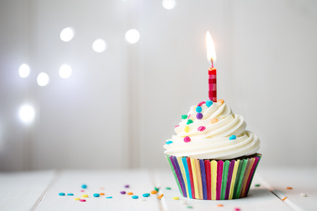 birthday celebration: Cupcake with a single candle Stock Photo