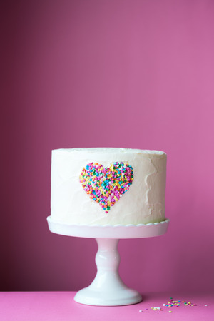 cakestand: Heart cake on a pink background