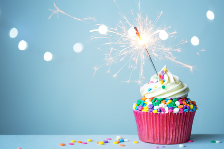 sparklers: Colorful cupcake with sparkler