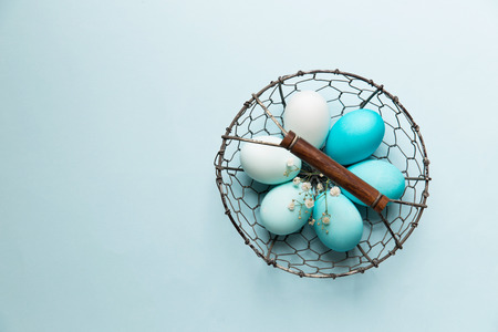 easter flowers: Easter eggs in a wire basket Stock Photo