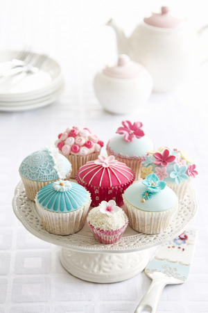 afternoon tea: Afternoon tea served with a variety of cupcakes Stock Photo