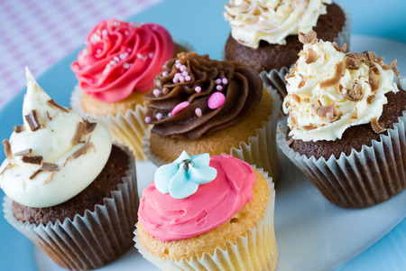 butter icing: Assortment of cupcakes on a plate