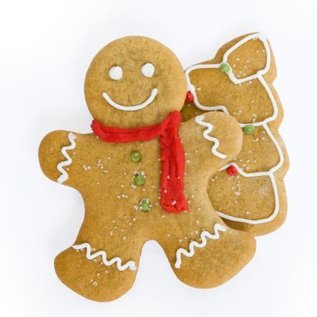 gingerbread man: Smiling gingerbread man and christmas tree cookie