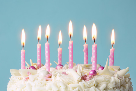 Birthday cake with pink candles Standard-Bild