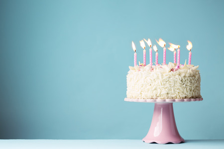 Birthday cake with pink candles Imagens