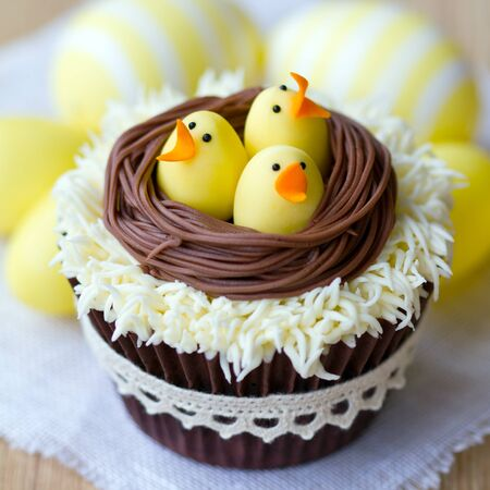 chick: Cupcakes decorated with fondant Easter chicks Stock Photo