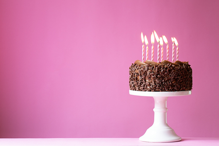 cakestand: Birthday cake with pink candles Stock Photo