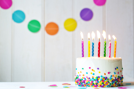 Birthday cake with colorful candles Archivio Fotografico