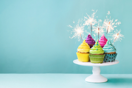 cake birthday: Cupcakes on a cake stand with sparklers Stock Photo