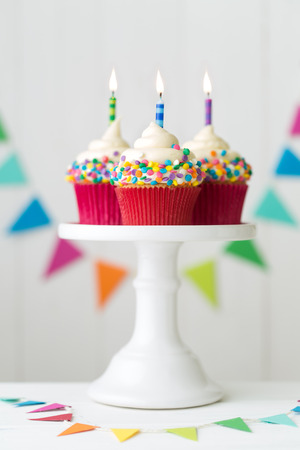 cakestand: Colorful birthday cupcakes on a cake stand Stock Photo