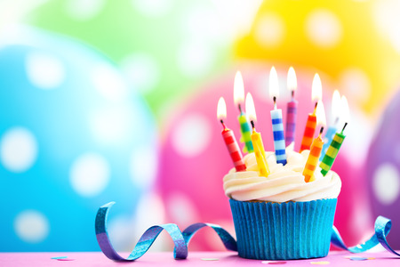 Cupcake decorated with colorful birthday candles