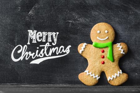 Gingerbread man against chalkboard background