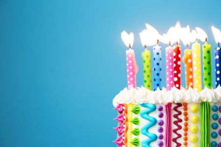Birthday cake with colorful candles Imagens