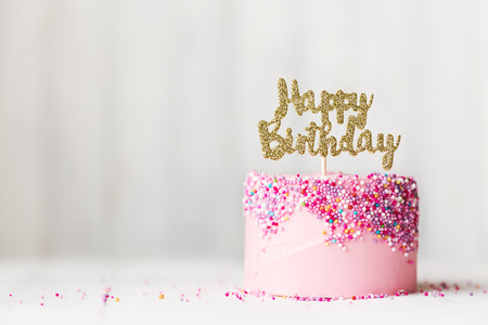 text pink: Birthday cake with sparkly banner Stock Photo