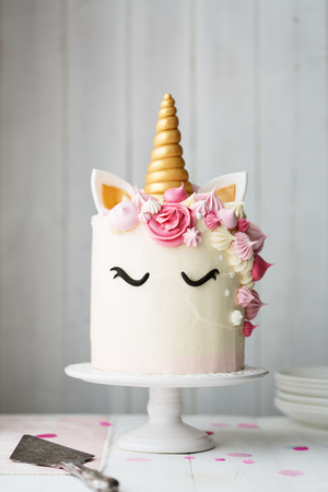 Unicorn cake on a cake stand Stock Photo