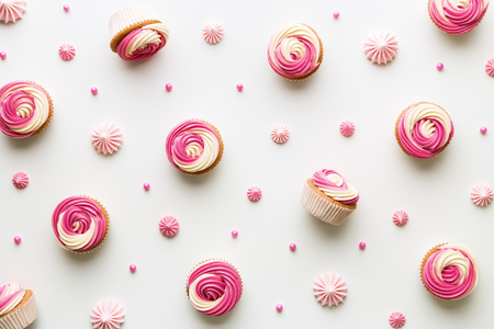 Pink cupcake background on white