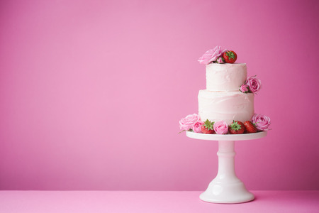 Cake decorated with fresh fruit and flowers