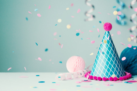 Party hat and falling confetti