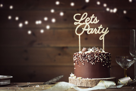 Chocolate celebration cake in a party setting Stock fotó - 80820165